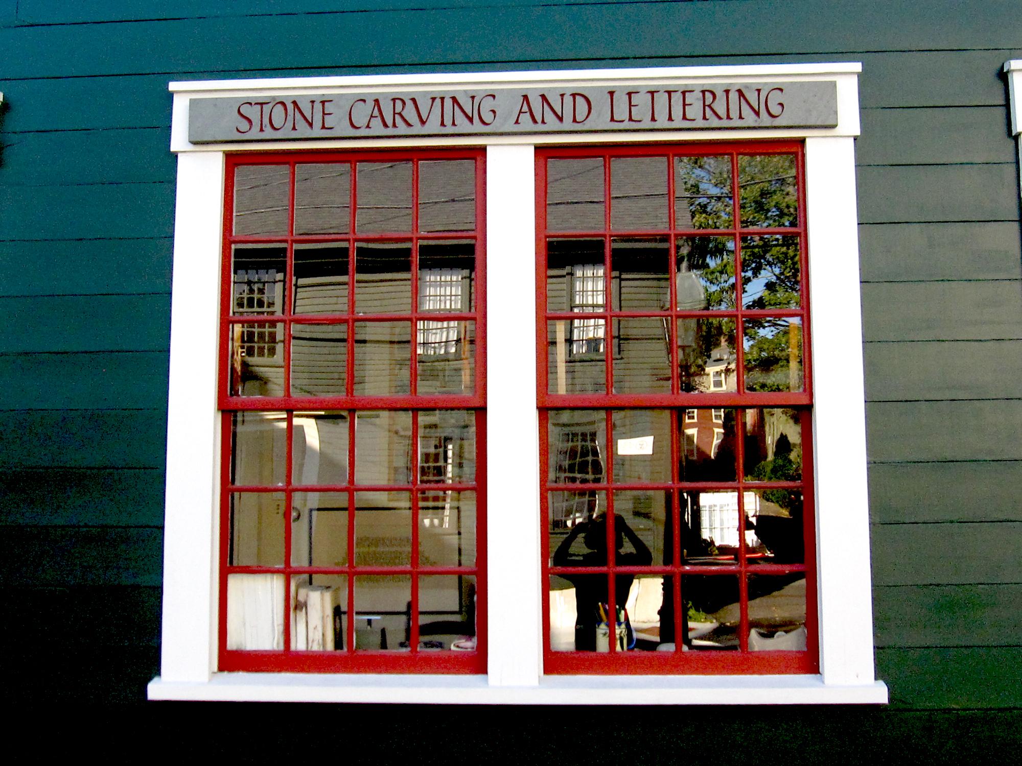 Window and sign at John Stevens Shop.