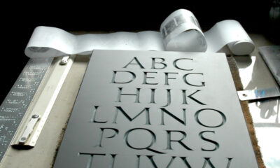 Slate with Roman alphabet carved by Jesse Marsolais.