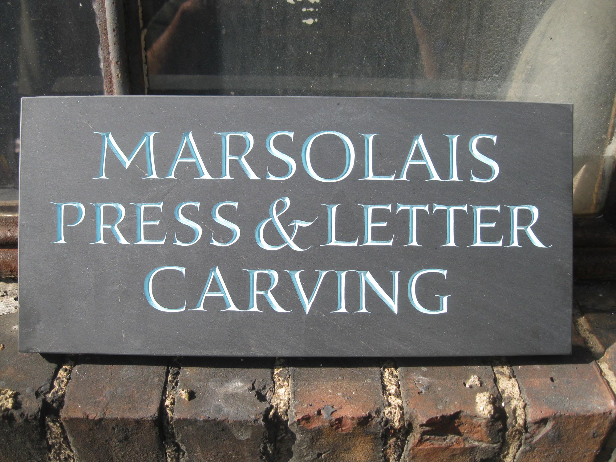 Sign for Jesse Marsolais shop.