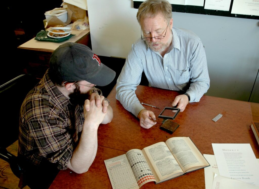 Jesse Marsolais and John Kristensen talking about typesetting process.