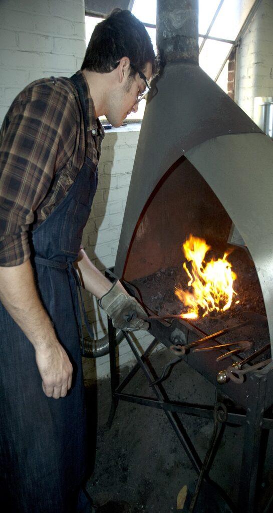 Derek Heidemann at the forge.