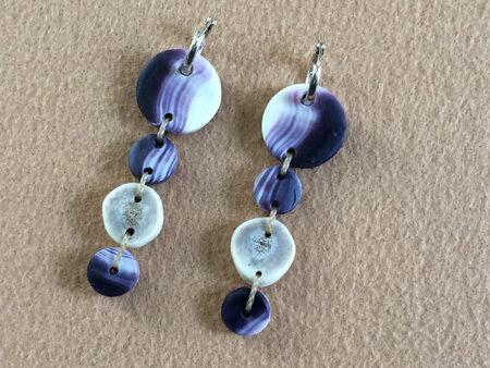 Pair of wampum earrings made by Elizabeth James-Perry.