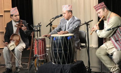 Nepali group of three performing.