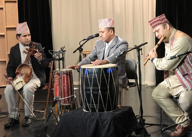 Nepali group of three performing.