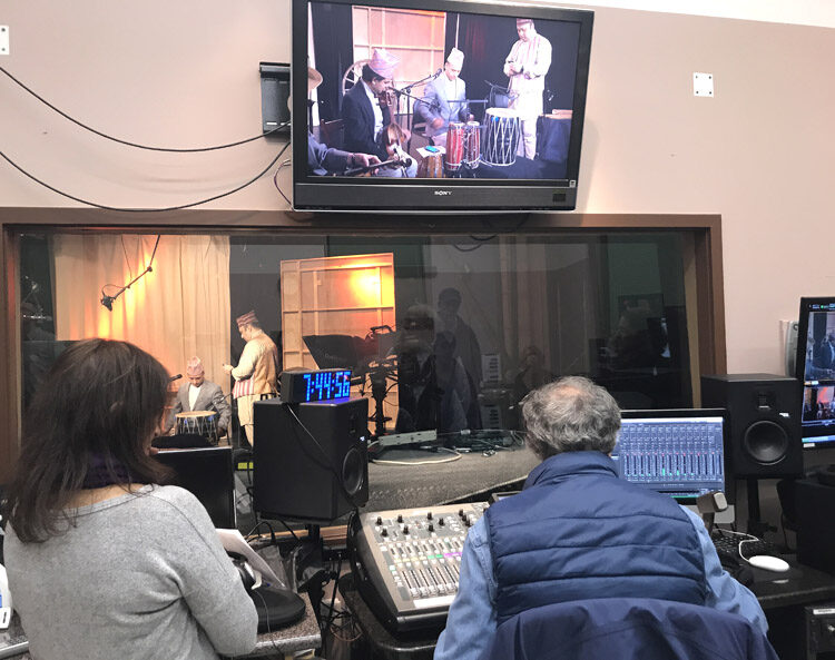 View from the recording console of group getting ready to perform.