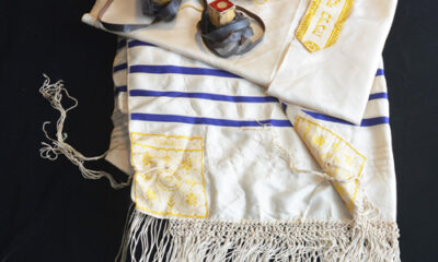 Tallis, tefillin, and velvet bag belonging to Maggie's father.