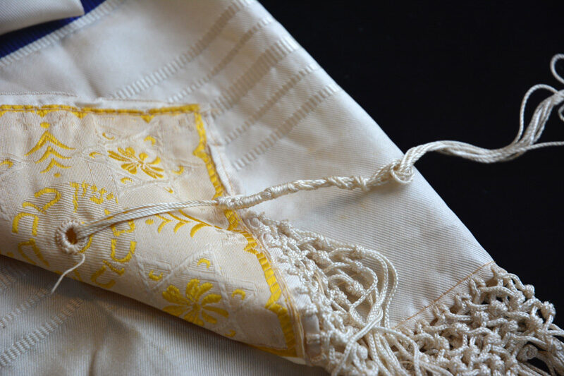 Corner of tallit belonging to Maggie's father, showing tzitzit.