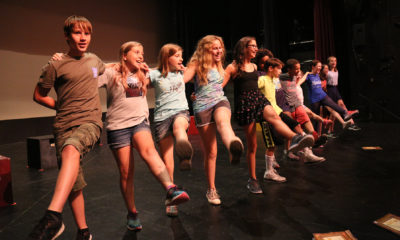 Young people rehearsing on stage at Wheelock Family Theatre