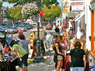 Sidewalk art sale in the Town of Plymouth. Photo by Denise Maccaferri.