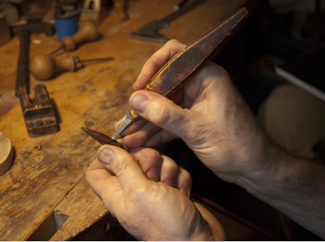 David Hawthorne making a bow by hand.