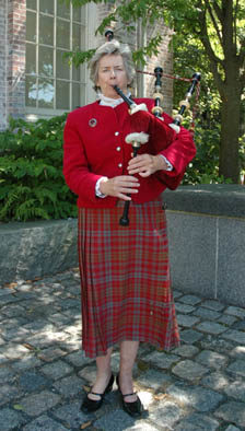 Nancy Tunnicliffe playing the Great Highland bagpipe.