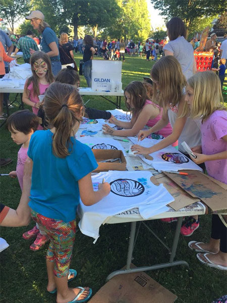 Youg girls color in t-shirts as an art project at the Belchertown Food Truck Festival. Photo by Jen Turner.