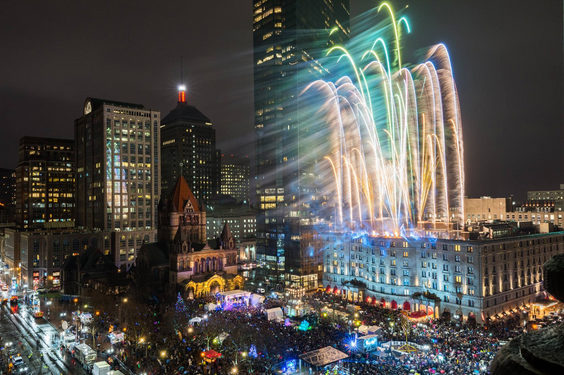 Fireworks going off over Copley Square in Boston at First Night.