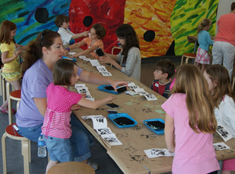 Family doing an art activity at Eric Carle Museum