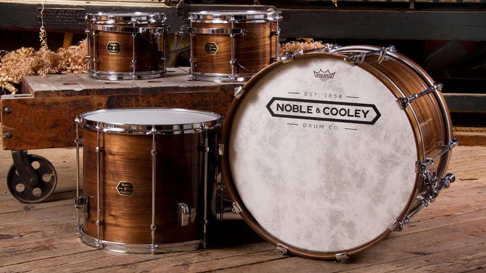 Walnut and gloss drum set