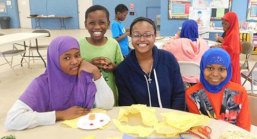 At Riverview Apartments, Fartun Iman, 12, Abdi Mohamed, 8, teacher Jerriah Prude and Manaisha Abdi, 11, exercise their creative skills.