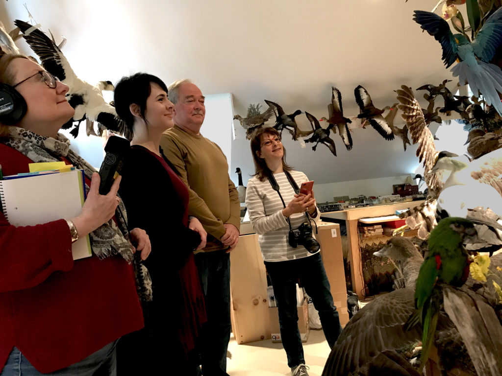 From left to right: Millie Rahn, Nicole Baldelli, Victor Cole, and Maggie Holtzberg admiring Victor Cole's bird taxidermy.