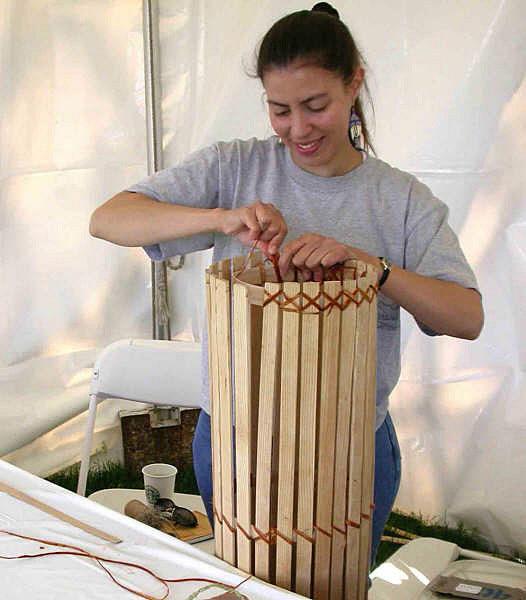 Elizabeth James-Perry building an eel trap.
