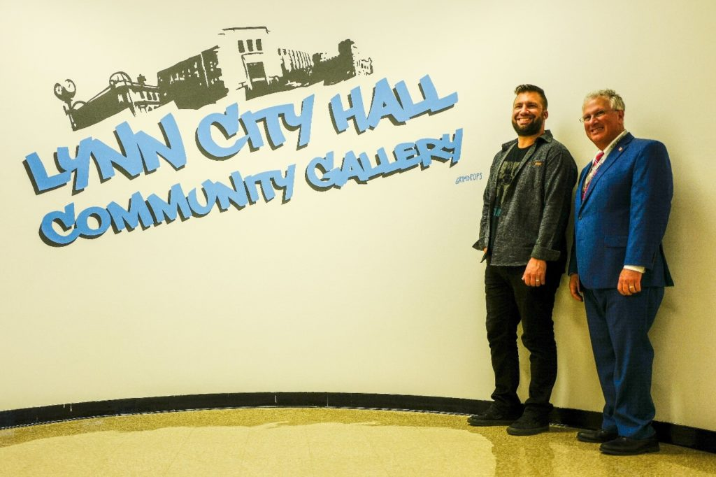 Artist Grimdrops poses with Mayor Thomas McGee in the new Community Gallery which will also still hold community meetings.