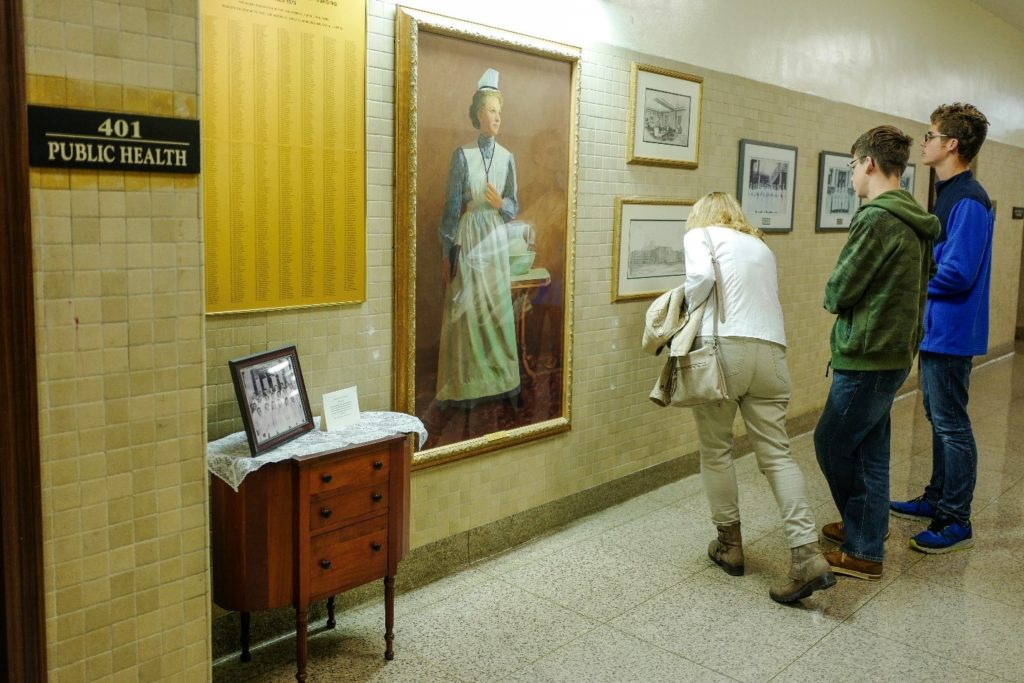Attendees peering at the photos from the former Lynn Hospital which is set just next to the entrance of the Public Health Department.
