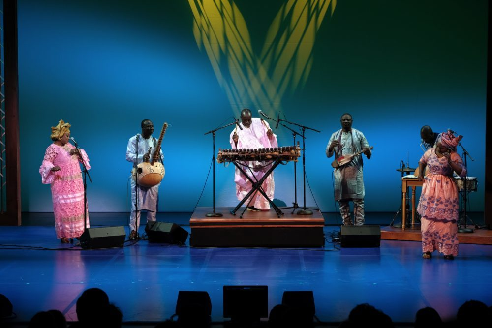 Balla Kouyaté performing (center) at the 2019 NEA National Heritage Fellowships Concert. Photo by Tom Pich.