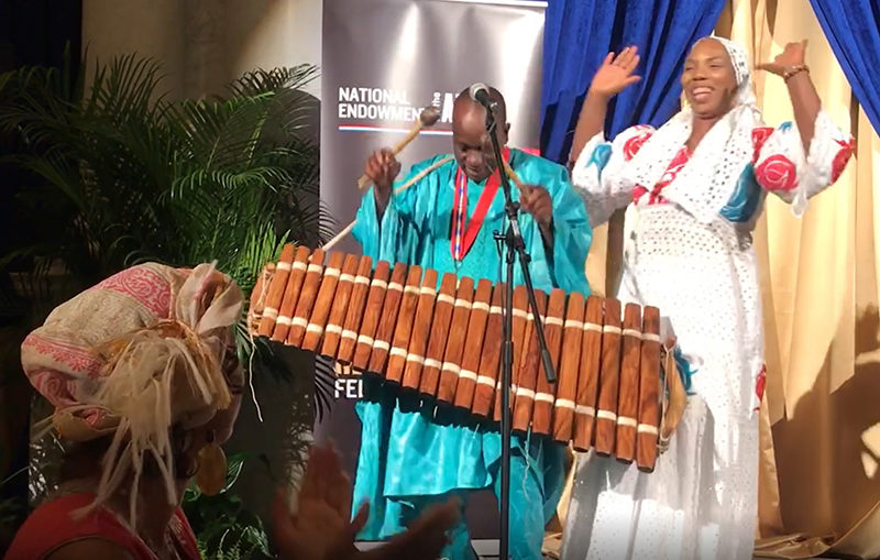 Balla Kouyaté performing at Fellowships banquet with his sister, Fanta Kouyaté. Photo by Maggie Holtzberg.
