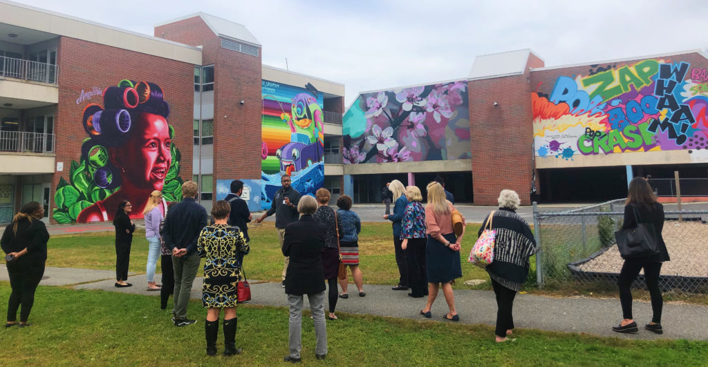 Attendees of the 2019 Cultural District Convening take in some of Worcester's murals.