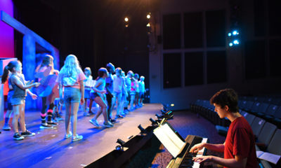 Young people rehearse on the stage of Greater Boston Stage Company in Stoneham, MA.