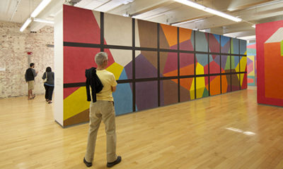 Man standing before Sol LeWitt's Wall Drawing 692 at MASS MoCA (Image: Zoran Orlic)