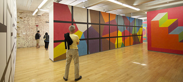 Man standing before Sol LeWitt's <em>Wall Drawing 692</em> at MASS MoCA (Image: Zoran Orlic)