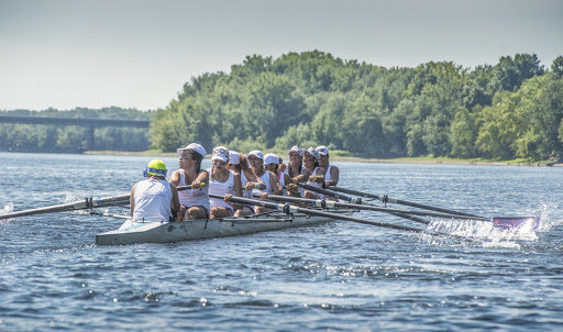 Young women rowing