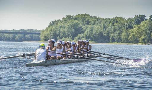 Young women rowing