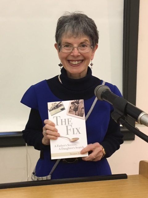 Sharon Leder, Founder of Creative Outlets at Cape Cod Museum of Art, holds a copy of her book, The Fix: A Father's Secrets, A Daughter's Search.