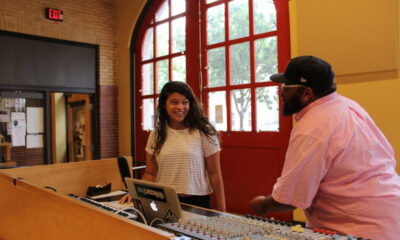 Corey DePina, musician and Youth Development and Performance Manager at Zumix, talks with a youth musician.
