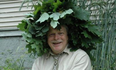 Jonas Stundzia of Lawrence, wearing a crown of oak leaves
