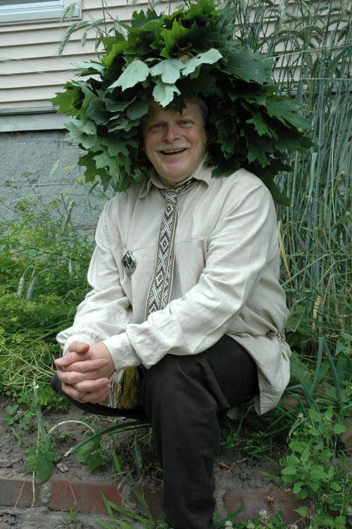 Jonas wearing a head garland made of oak leaves.