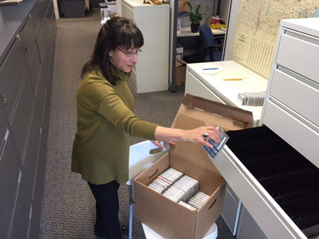 Maggie boxing up cassettes.