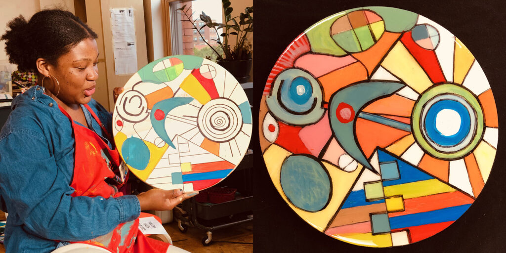 Hannah Parker holding a piece of spinning art she created