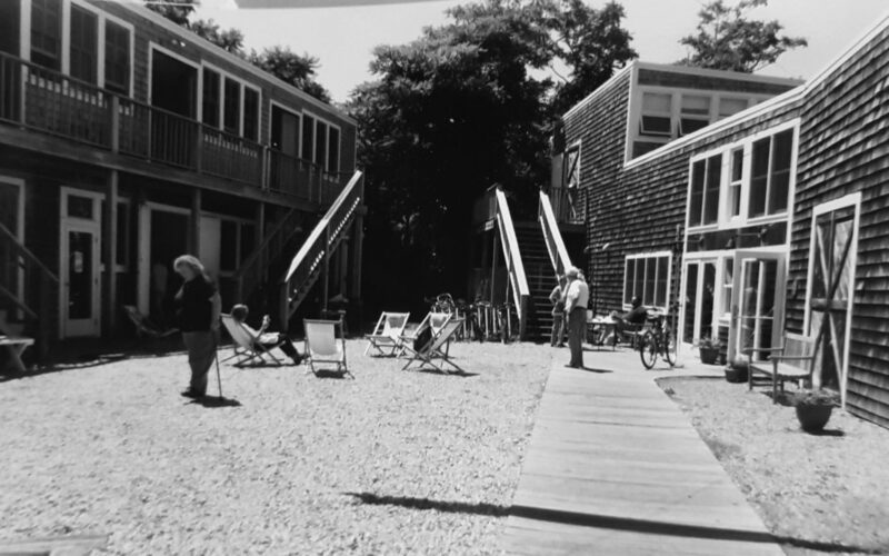 People scattered in courtyard at the Fine Art Works Center in Provincetown
