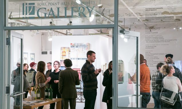 People gathered inside a gallery at Fort Point Arts Community