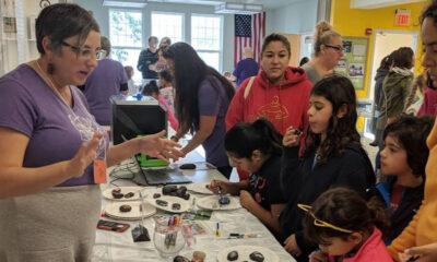 Children paint rocks at a maker space