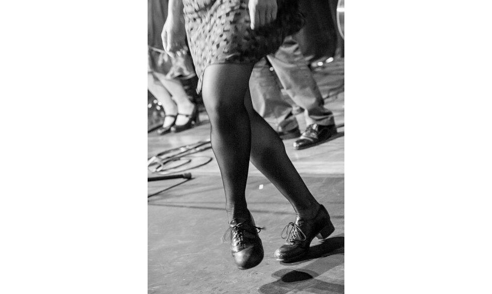 Kieran Jordan dancing on stage at Shalin Liu. Photo by Brendan Mercure.