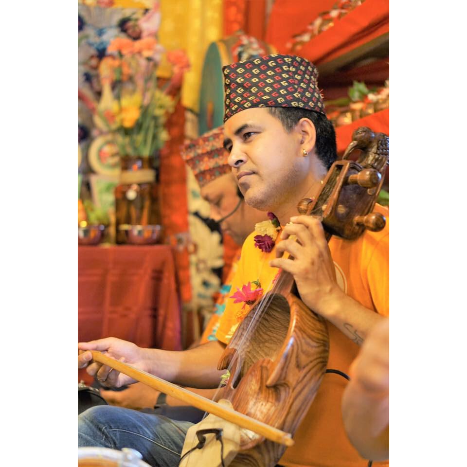 Shyam Nepali playing the sarangi. Photo courtesy of Shyam Nepali.