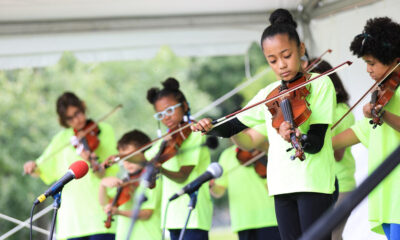 youth ensemble playing at an outside arts festival