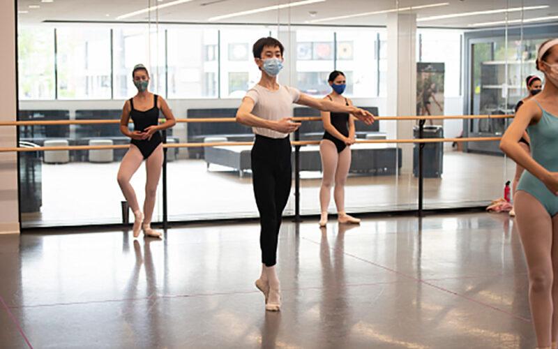 Boston Ballet students wearing masks in the dance studio