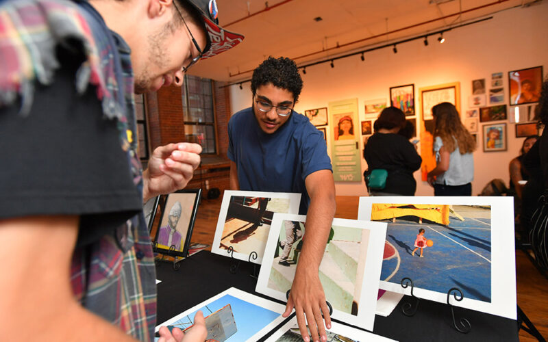 People viewing artwork table in a gallery