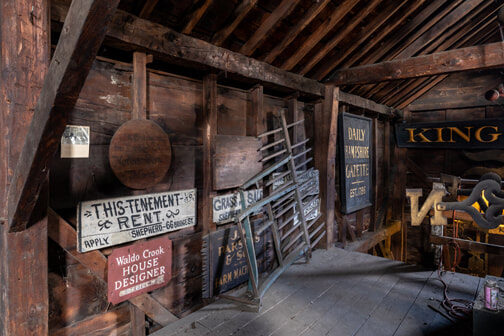 Antique signs hung inside the Sheppard Barn