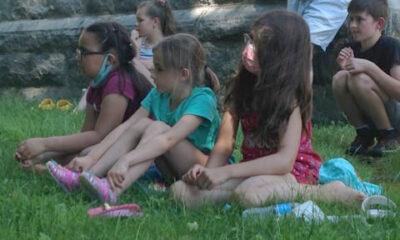 3 girls sitting in the summer grass