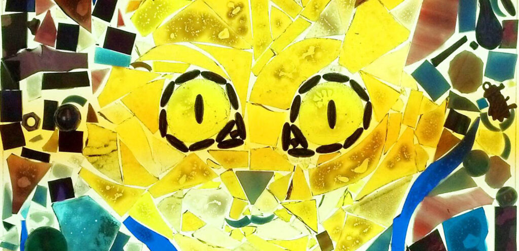 collage artwork featuring a bright yellow cat face